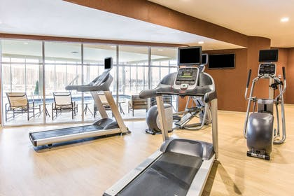 Exercise room with cardio equipment and weights | Cambria Hotel Cleveland Avon