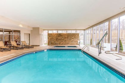 Indoor pool with hot tub | Cambria Hotel Cleveland Avon