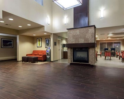 Relax by the fireplace in the lobby | Comfort Suites Central/I-44