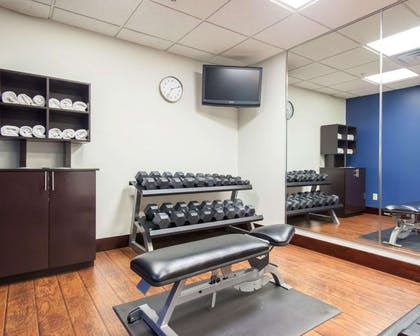 Exercise room with free weights | Comfort Suites Central/I-44