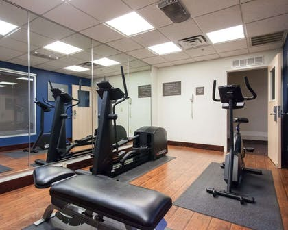 Exercise room with cardio equipment | Comfort Suites Central/I-44