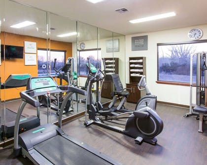 Fitness center with cardio equipment and weights | Comfort Suites Idabel