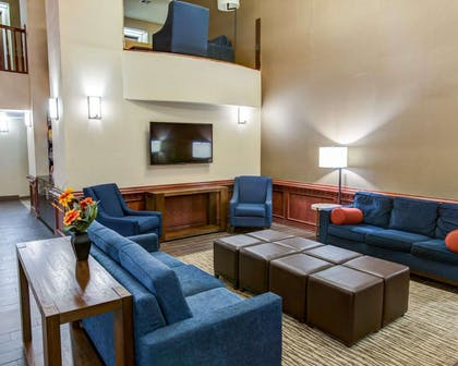 Spacious lobby with sitting area | Comfort Suites Idabel