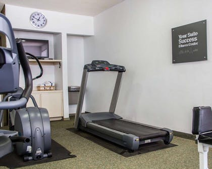 Fitness center with cardio equipment and weights | Comfort Suites McAlester