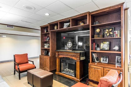 Relax by the fireplace in the lobby | Comfort Inn & Suites Ardmore